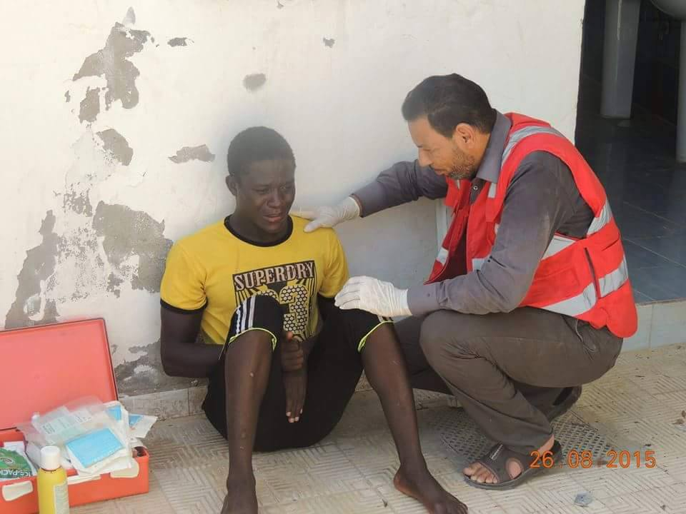 A survivor from the Wednesday capsizing - in which 12 people are believed to have lost their lives - being comforted by an aid worker for with the Libya Red Crescent.
