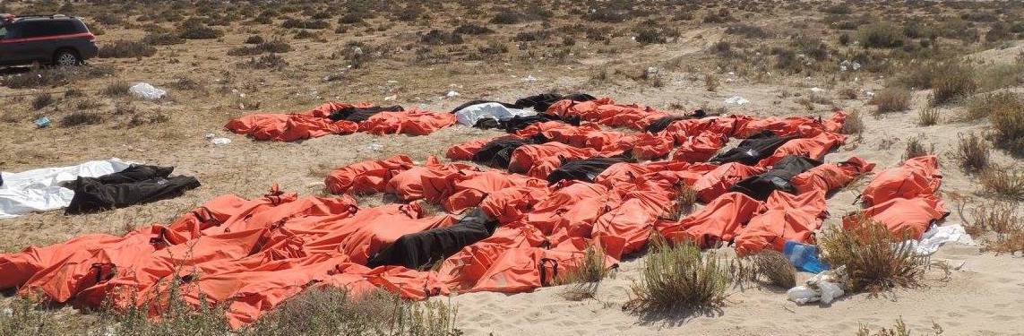 Dozens of body bags stacked next to each other in Abu Kammash, in a beach close to the border with Tunisia.