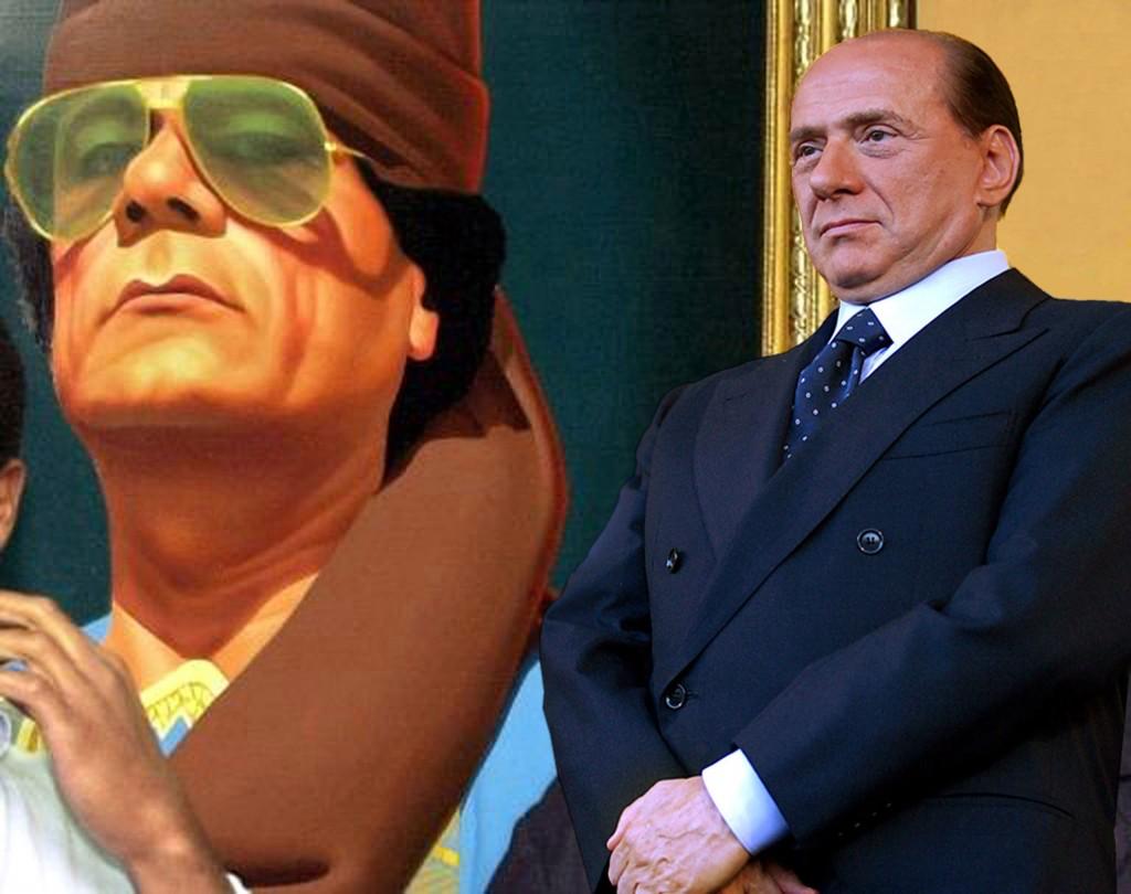 ©Roberto Gimmi Fotomontaggio di Silvio Berlusconi con alle spalle un quadro di Gheddafi