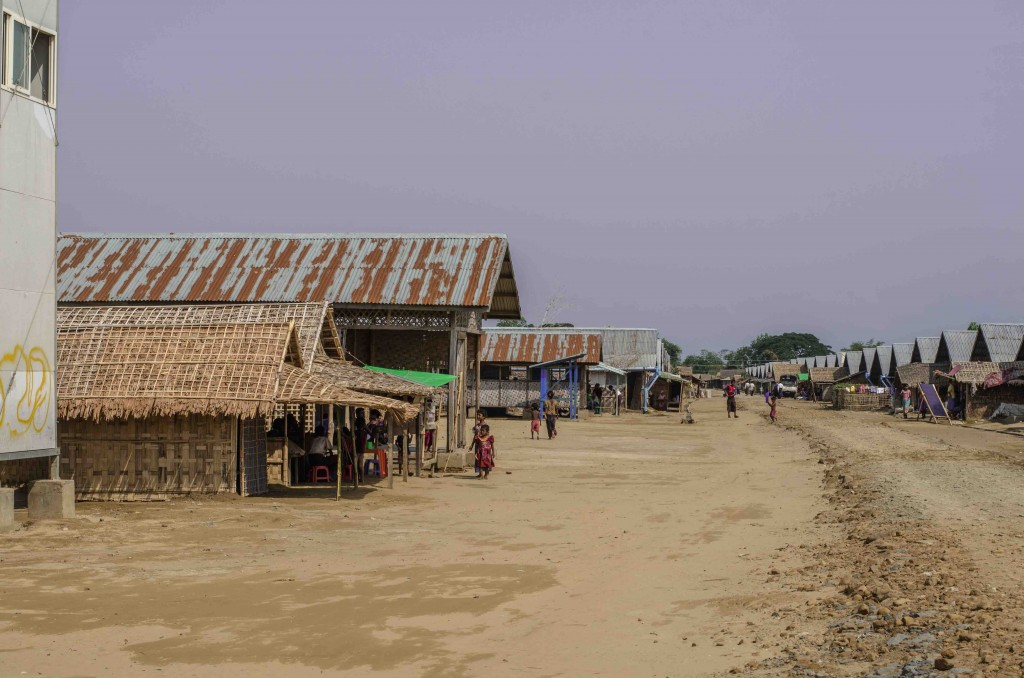 The main strip of Say Tha Mar Gyi IDP camp, near Sittwe, Myanmar, on May 25, 2015. More than 100,000 Muslims remain confined in camps around the Rakhine State capital (Alex Bookbinder).