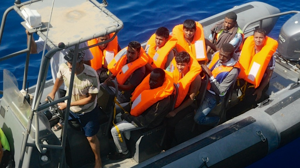 The Libyan coastguard assisting a rescue operation carried out by the Migrant Offshore Aid Station (MOAS) off Libyan waters. Photo: Moas.eu