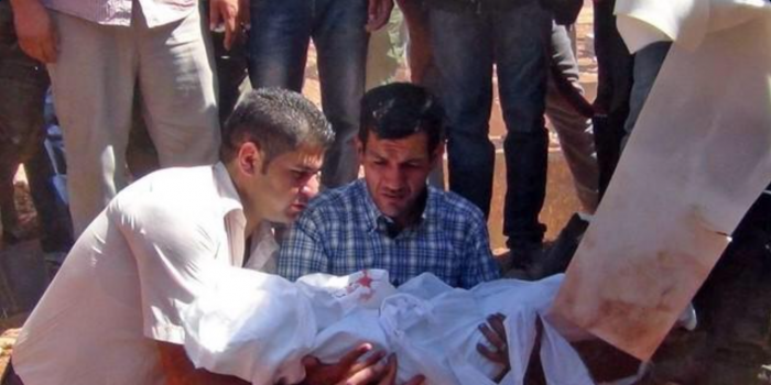 Aylan Laid to Rest with Brother and Mother in Kobani