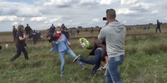 Hungarian Camerawoman Caught Kicking and Tripping Refugees on the Run